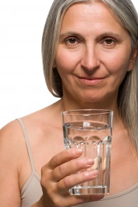 Mature woman drinking mineral water
